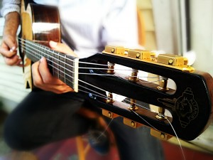 close-up angled guitar on lap